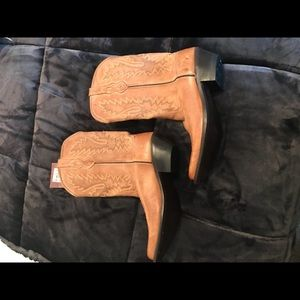 Cowboy boots.  Complete leather wood heel